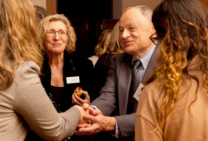 The bold Dr. David Olds shakes an attendees hand.