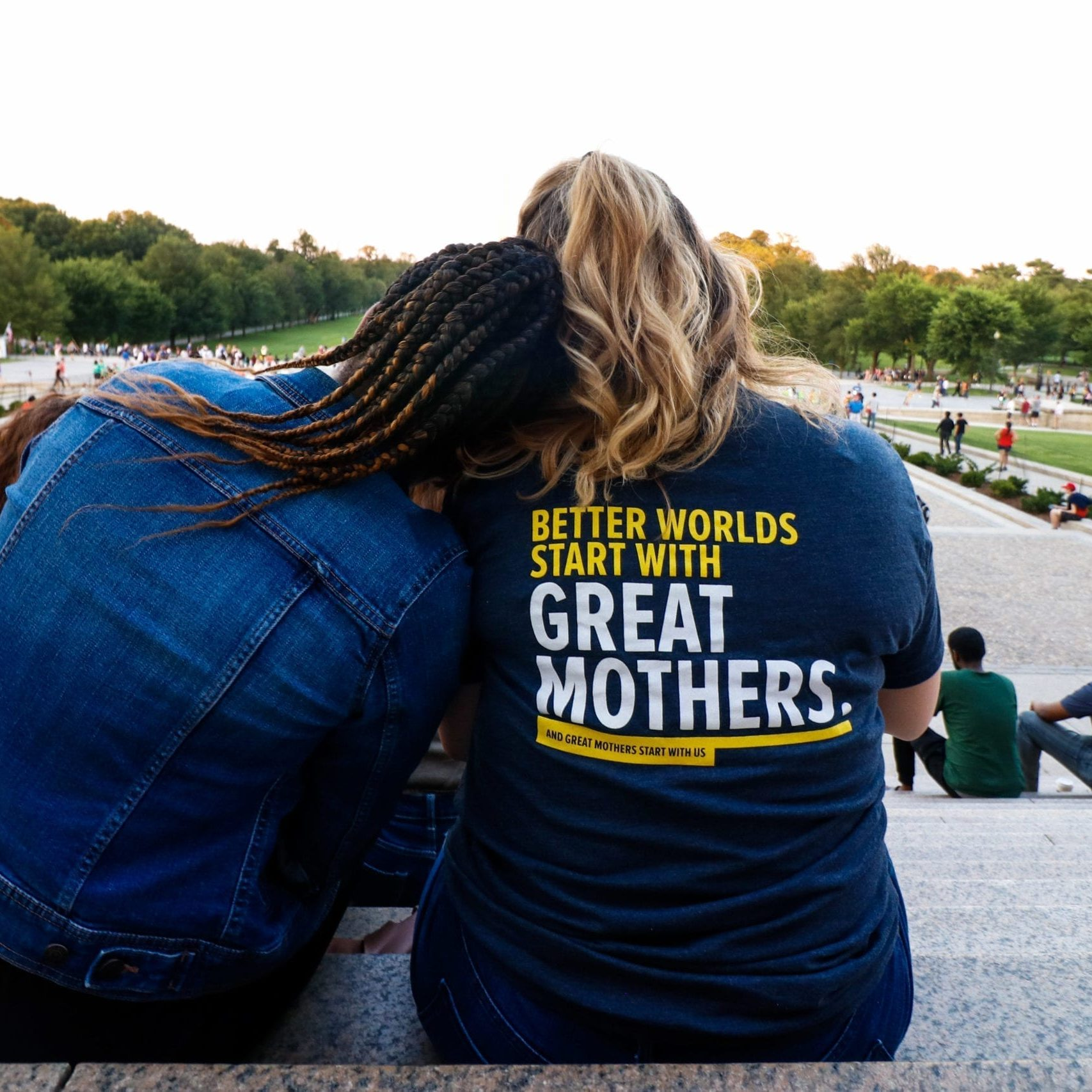 Parent Ambassadors Gayle and Allison soaking in the environment around them while sitting at the steps of the Lincoln Memorial at the Parent Ambassador social event outing